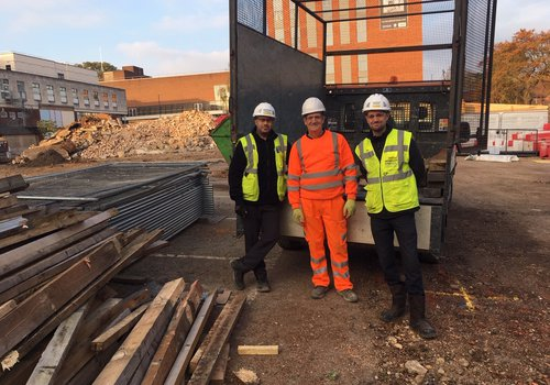 The team at the CCOS St Albans project handing over more timber to be recycled