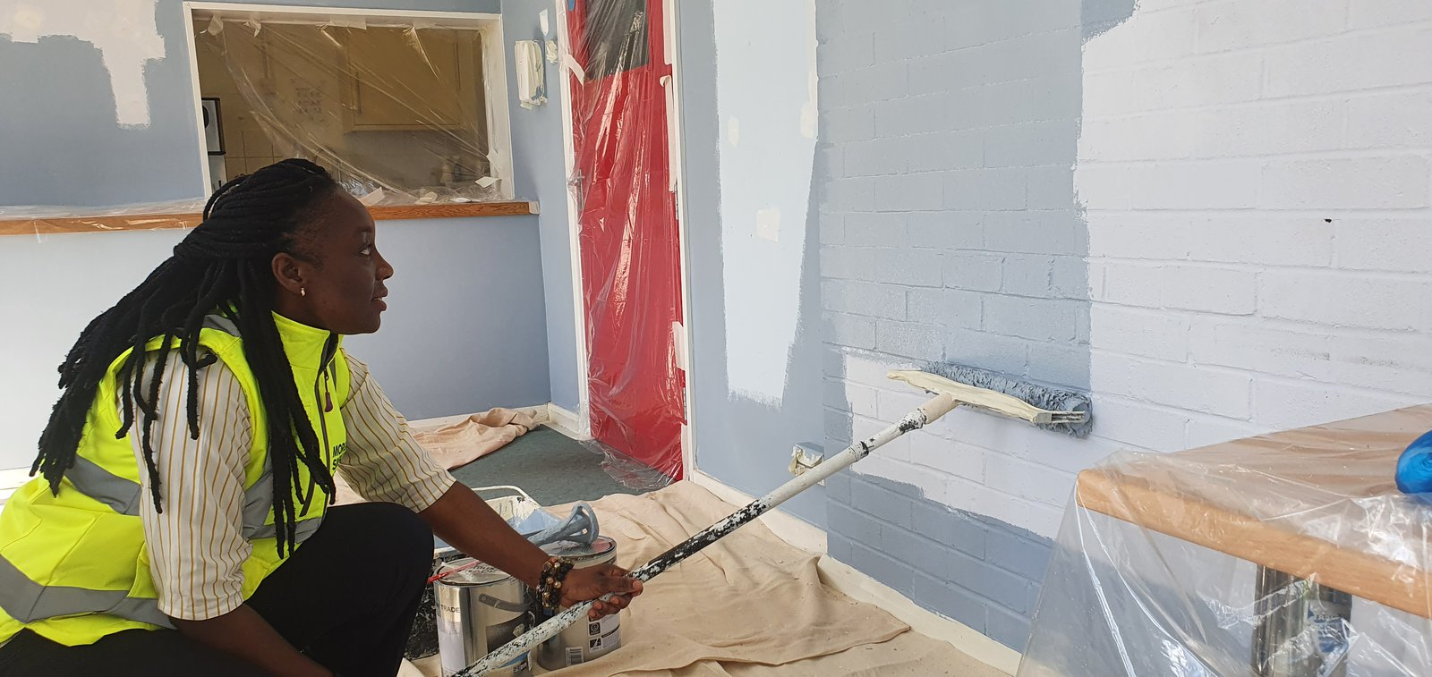 Image of Morgan Sindall Construction employee taking part in Neighbourhood Week, painting Sandy Fire Station
