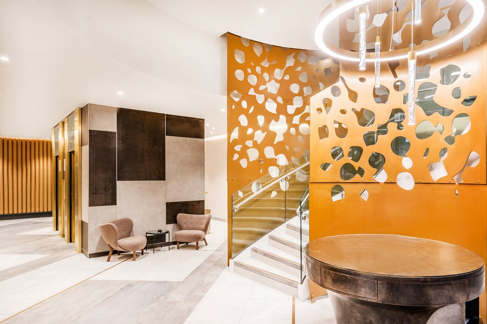 Interior of Great Central Square, Leicester (Project Medius), the decoration of the hotel features gold and white themed materials and colour