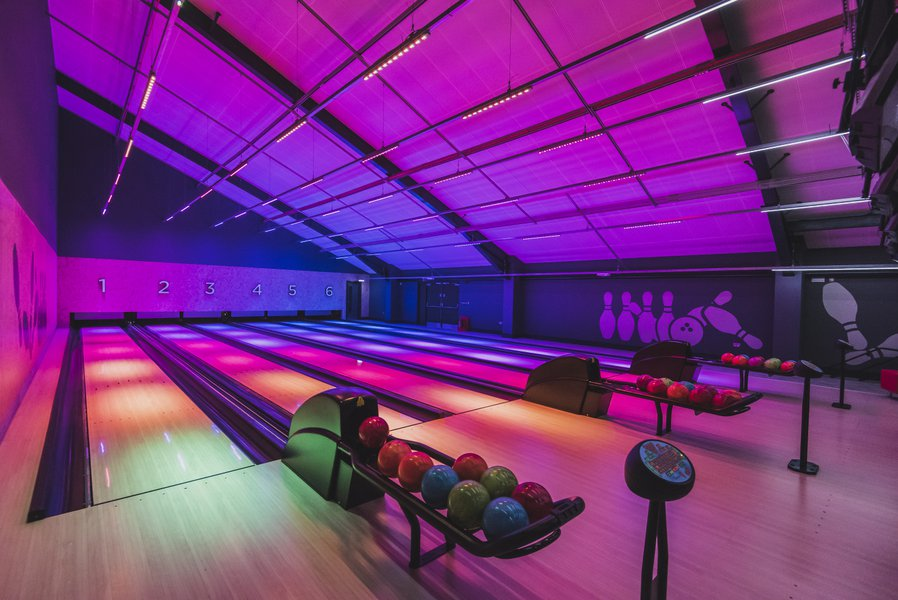 Bowling alley, with pink and purple lighting