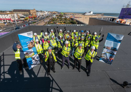 Topping out ceremony attendees on the roof of the Great Yarmouth Marina Centre building