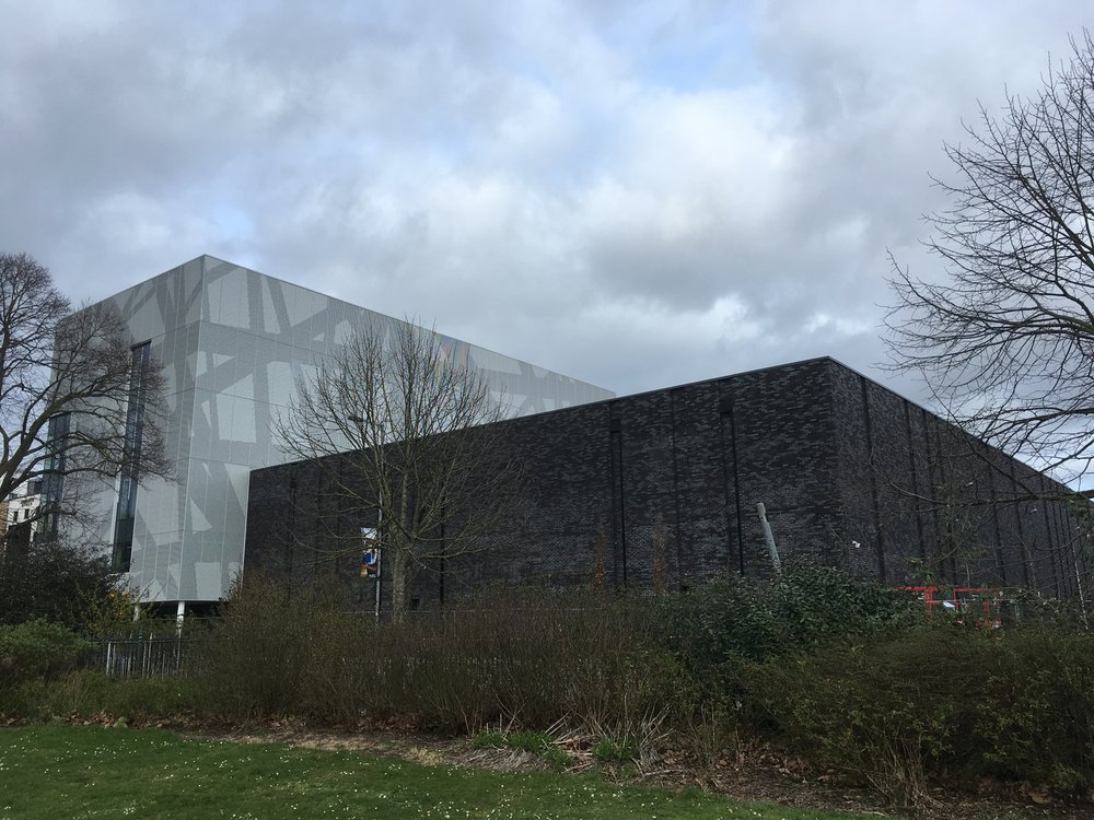 Rear building - southampton solent sports complex which is covered in brick cladding