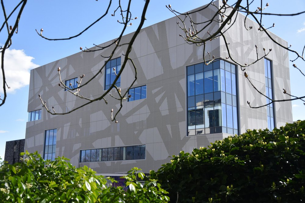 The front part of Southampton Solent Sports complex, which is adjacent to a park area. The mesh cladding features a geometric pattern