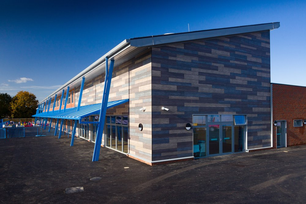 Side view of Hailsham Primary school showing the grey, cream and blue cladding