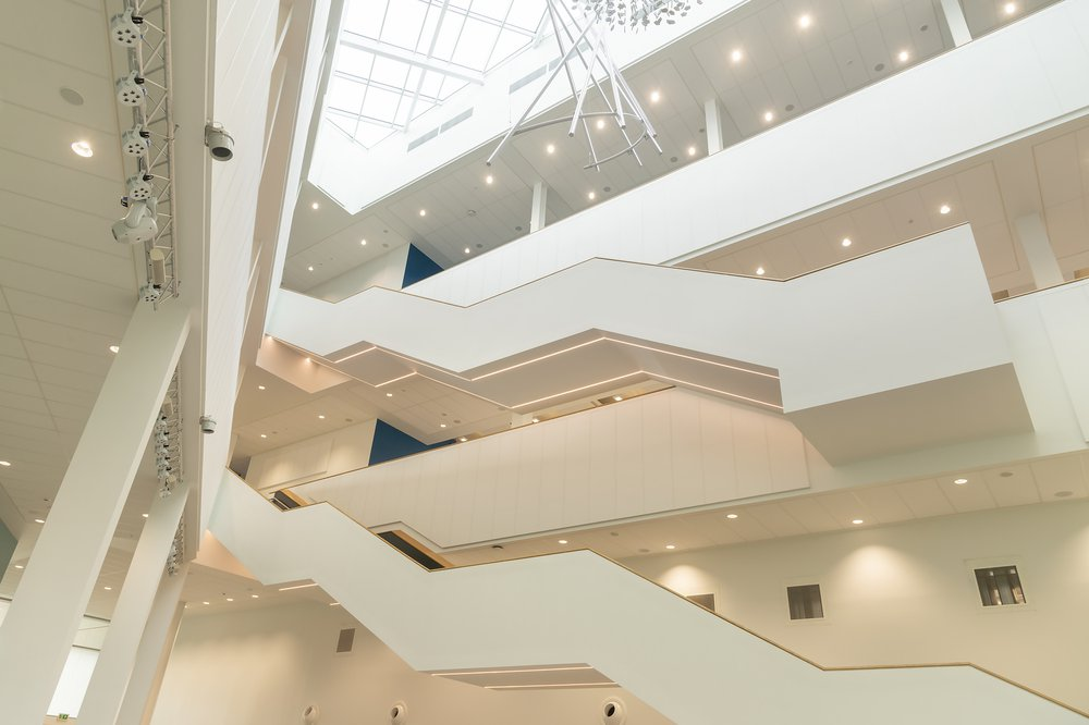 Interior view of the Barbara Hepworth Building for the University of Huddersfield that show the geometric staircases in the atrium