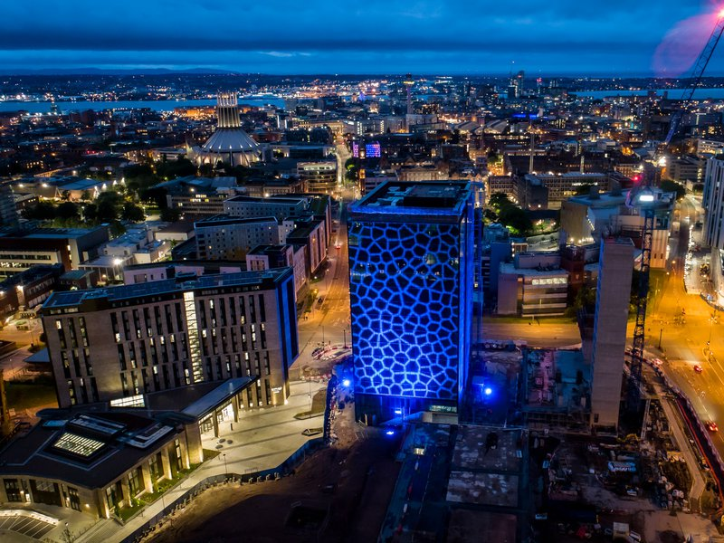 The Spine building in Paddington Village in Liverpool lit in blue lights for the NHS Birthday
