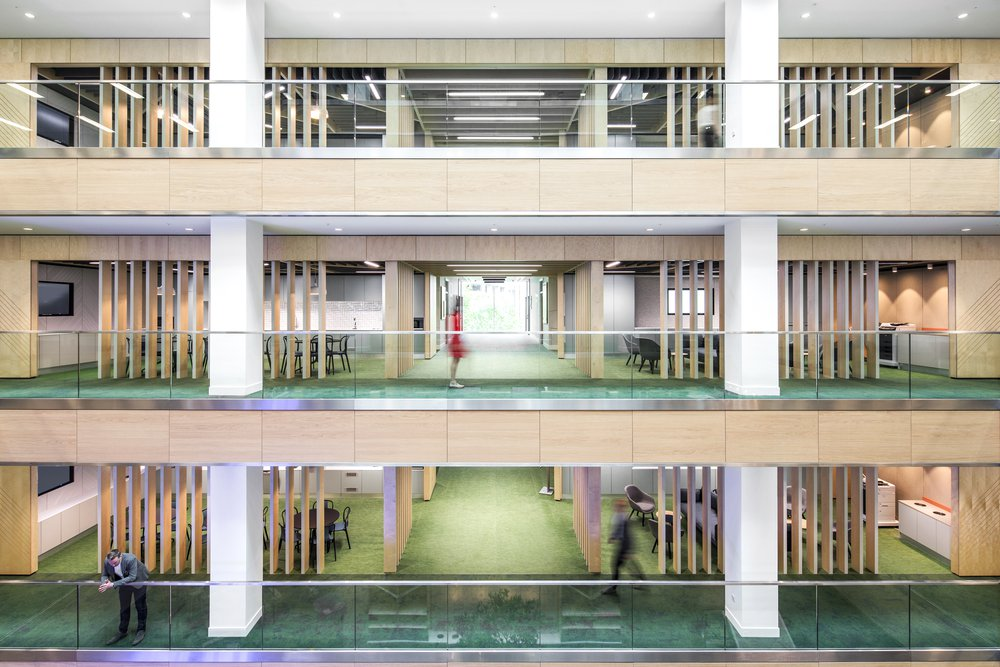 Interior of the Bupa UK headquarters, image shows three of the buildings floors from the mezzanine