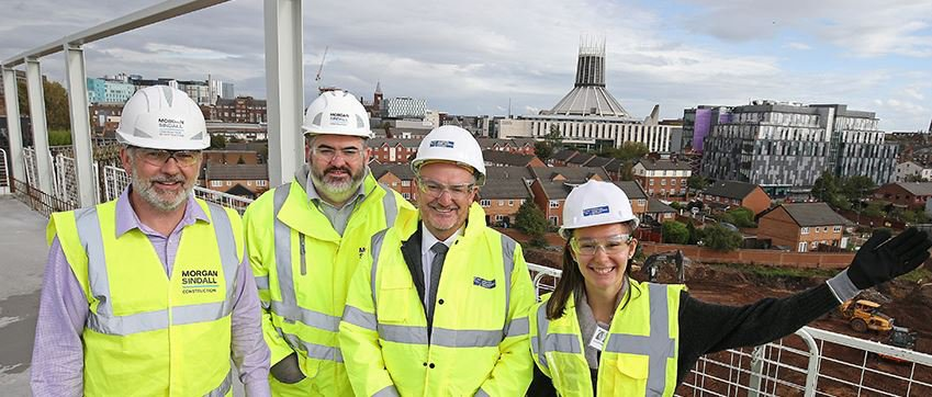 Image taken at the Copperas Hill topping out event, the team are standing on the top of the building