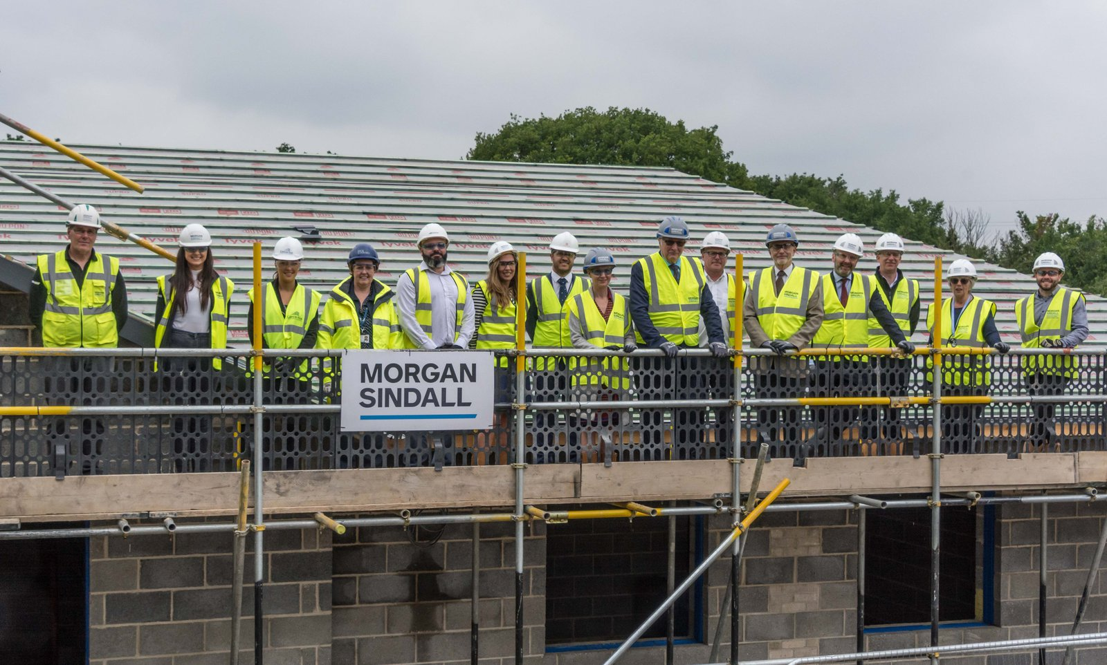 Image of the team at the Topping Out Ceremony for Glenwood School student accommodation project