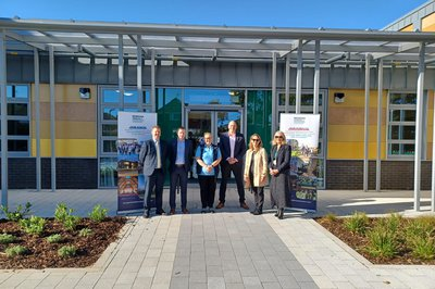 The team at Hillbourne School handover event in front of the school entrance