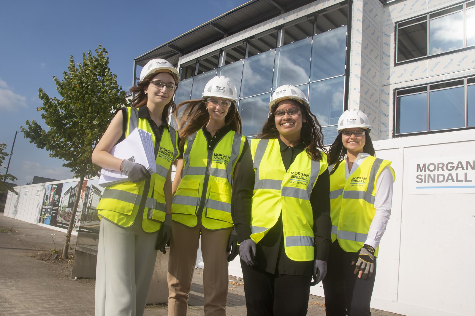 Four female members of the Morgan Sindall Construction team wearing Personal Protective Equipment