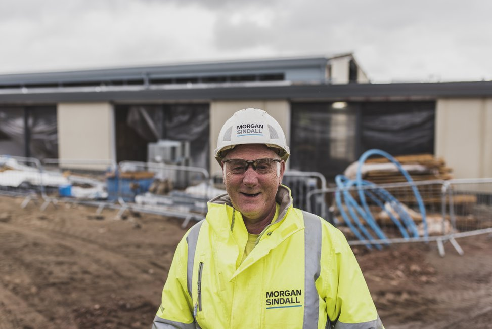 A Morgan Sindall Construction employee pictured on site