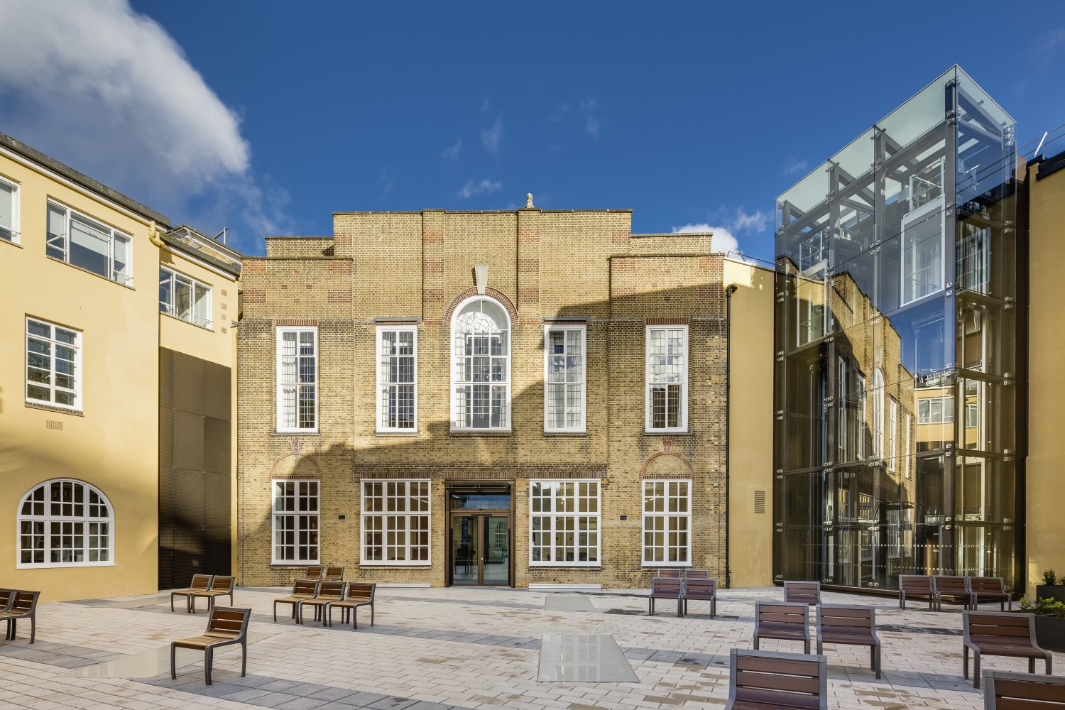 The rear of the Lambeth Town Hall building, a grade two listed building with a glass atrium added