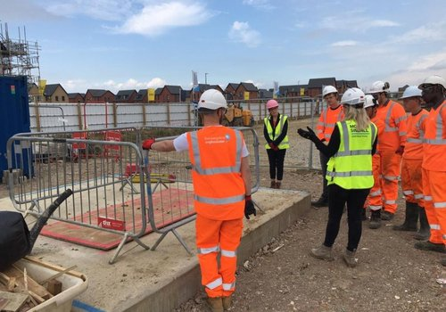MK College students on a site tour of the Glebe Farm School project