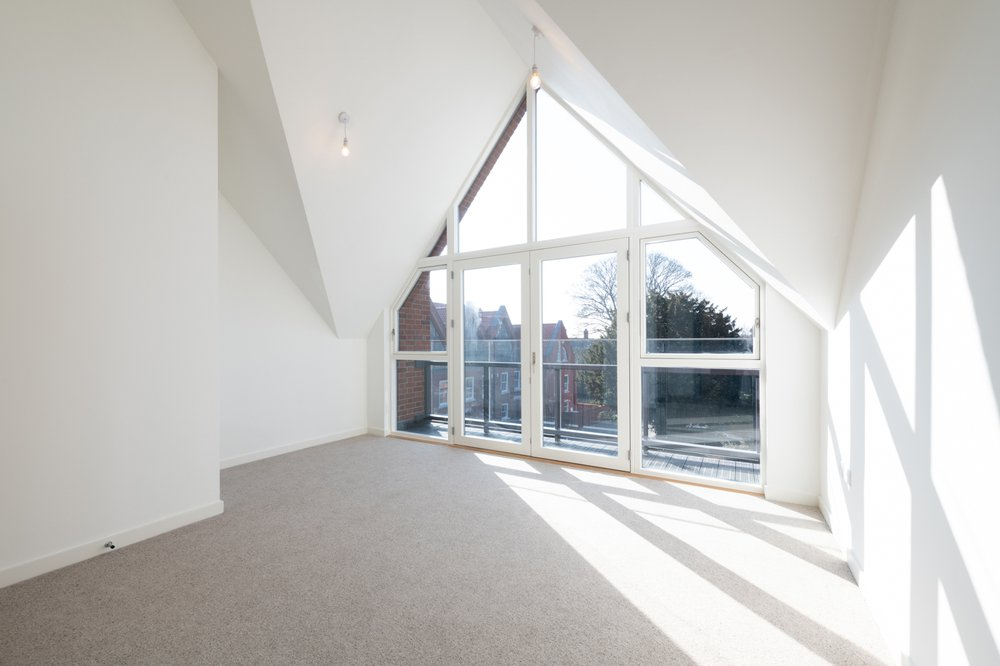 View from the top floor of one of the Museum of St Albans residential builds looking out of the floor to ceiling triangular window