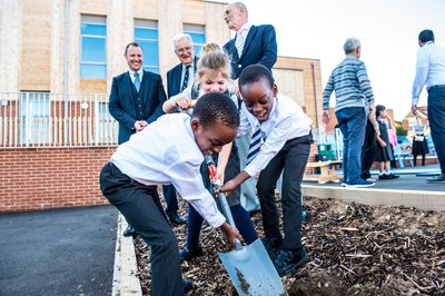 A group of children at a ribbon cutting event at Magna Carta School in Stanstead