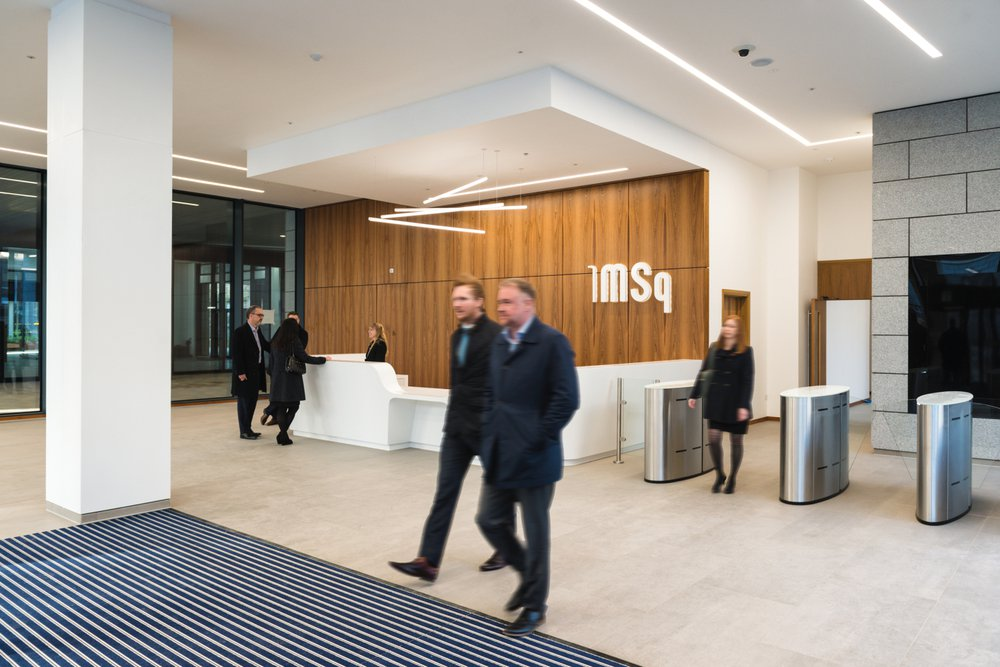 Two men walking through a reception area in one of the office buildings in Marischal Square in Aberdeen