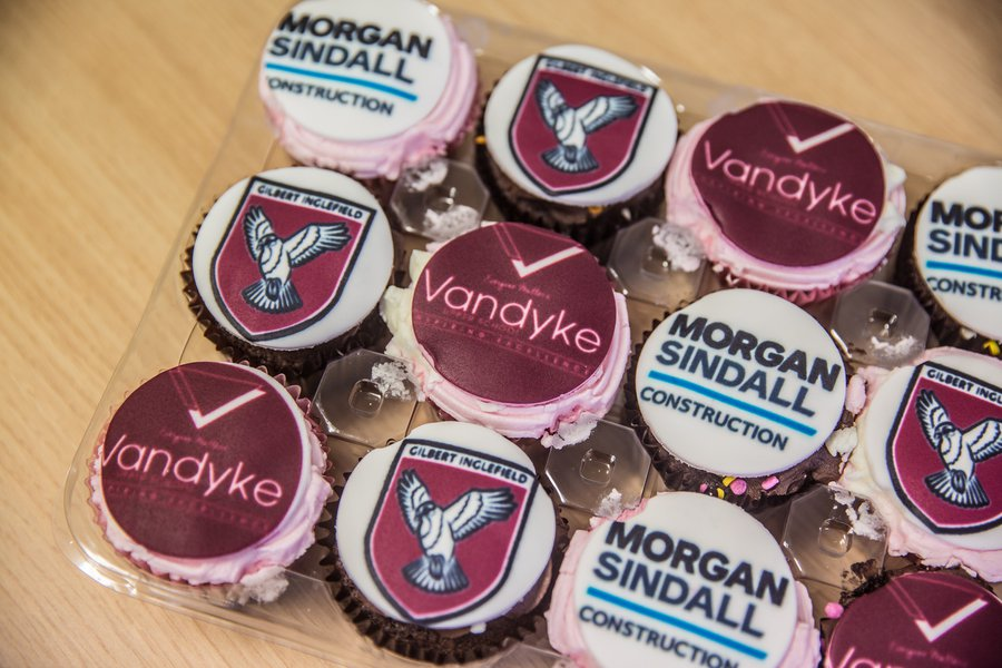 A tray of Morgan Sindall Construction and Vandyke School branded cupcakes at the schools handover event