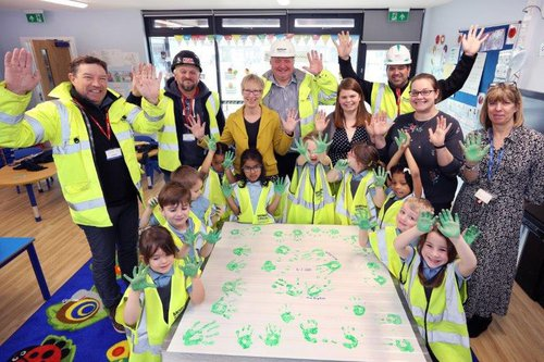Morgan Sindall Construction employees and school children and teachers at a time capsule event