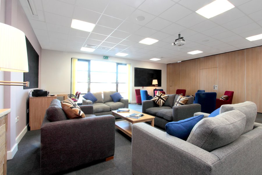 Picture of the lounge area complete with comfy sofas and decor at the Royal Marines recovery centre