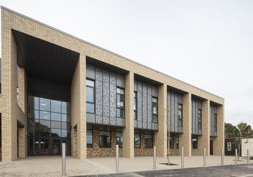 Image of the front entrance to Rockwood Academy School in Birmingham, showing the brick cladding system used all over the building