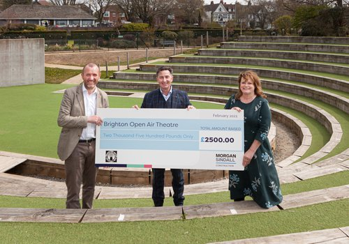 Image of the Morgan Sindall Construction team presenting a giant cheque to BOAT charity