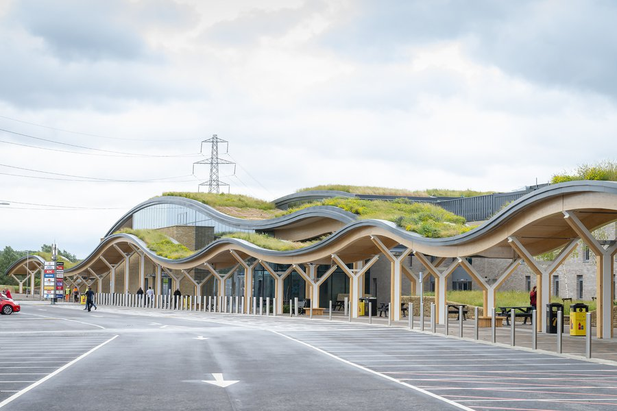 Entrance to Skelton Lakes Service station which features a wavy designed, green living roof
