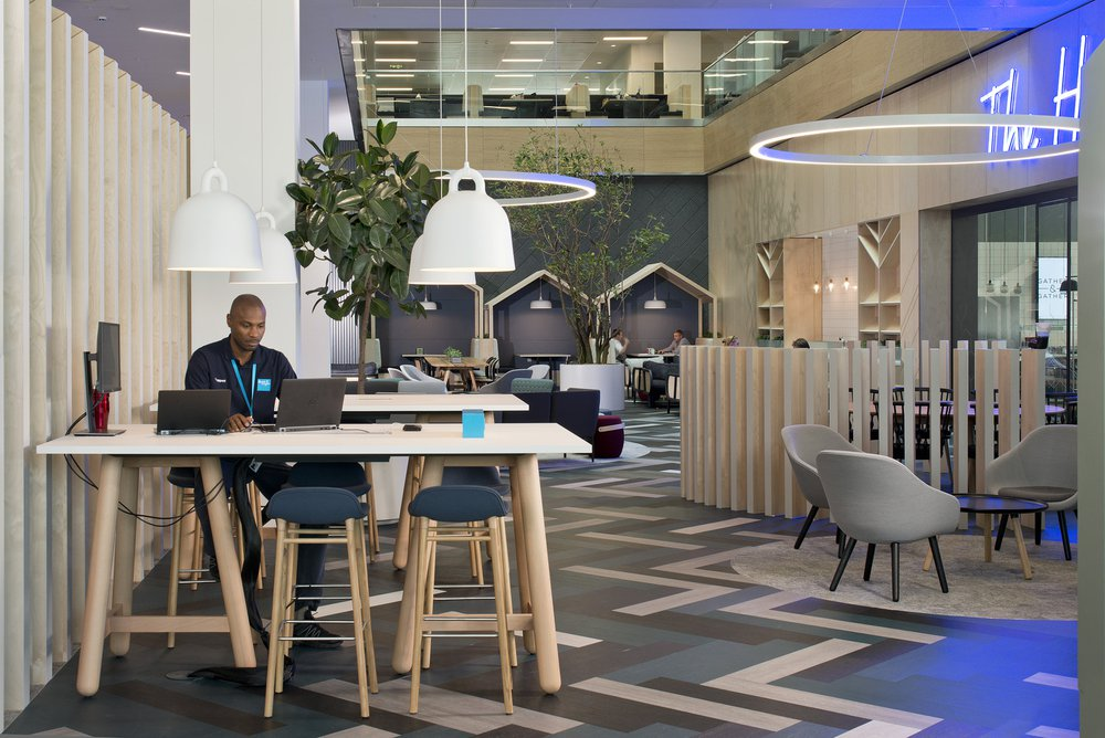 Image shows someone working in a flexible workspace within the mezzanine area of the Bupa UK headquarters