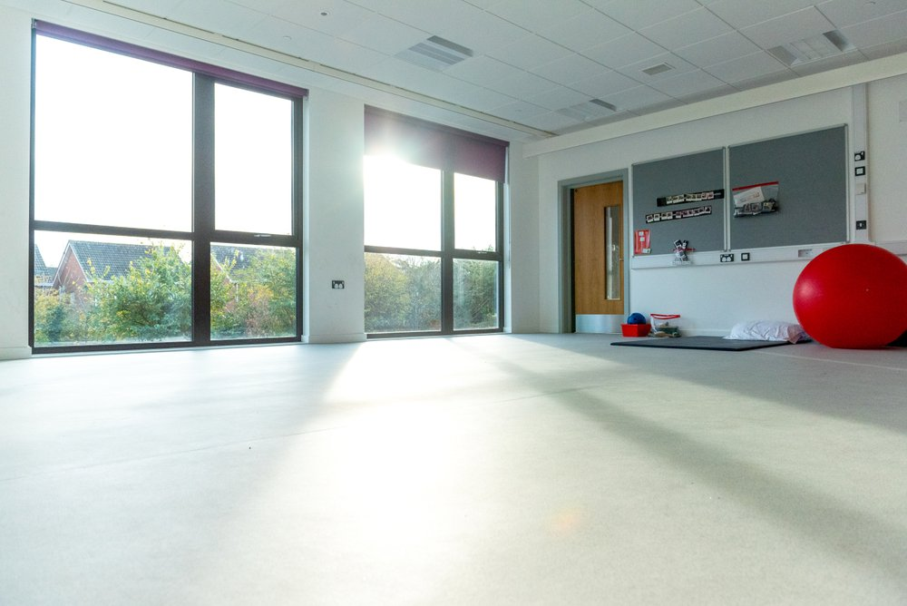 Studio classroom at the Glenwood SEN School in Essex, the image shows the large floor to ceiling windows as part of the building design