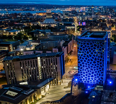 The Spine building in Paddington Village in Liverpool which was lit blue for the NHS Birthday