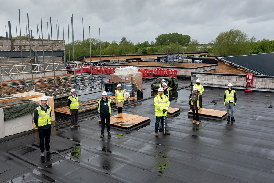 Picture of the topping out ceremony at Orion School