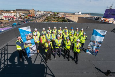The team on the roof of the building at the Great Yarmouth Marina Centre Topping Out Ceremony