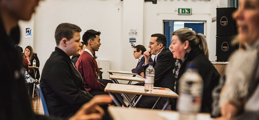 Image of Bob Ensch of Morgan Sindall Construction at a schools careers event talking to a student