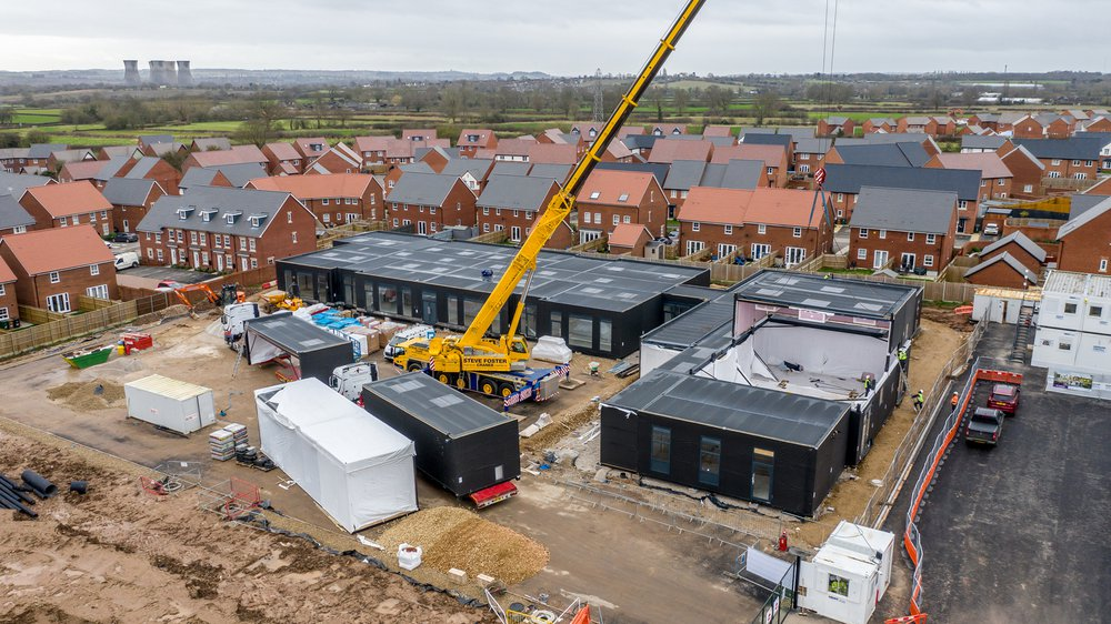 Aerial view of the 45 building modules being craned into site at the Highfields Spencer Academy project