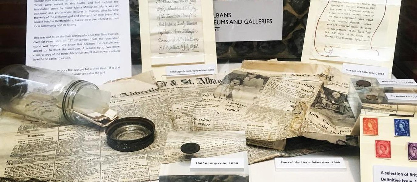 A selection of the items found in the time capsule at the Museum of St Albans residential scheme including, old newspapers, currency and handwritten notes