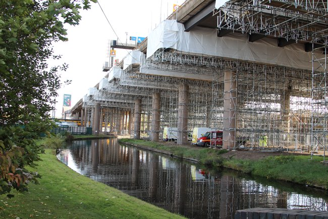 A photograph looking up from below the M5 Oldbury viaduct, showing the complex scaffolding on display