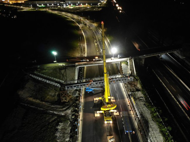 An aerial view of nighttime work taking place at the A421 project