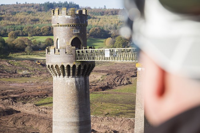 A colleague is pictured looking out at a tower on Wentwood Reservoir, which we can see over their shoulder.
