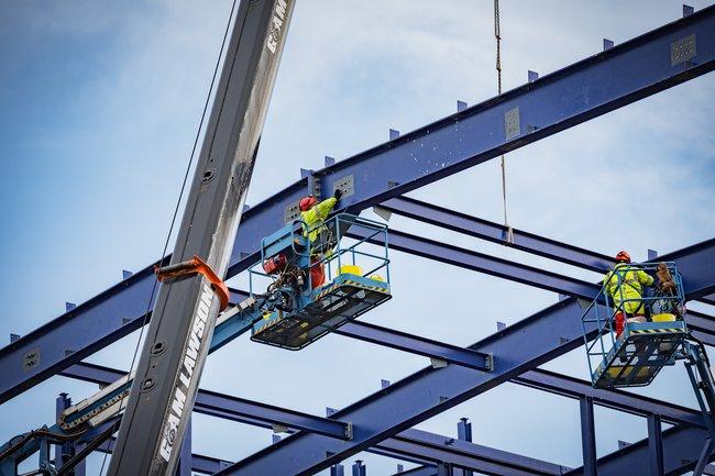 A colleague working on steel beams