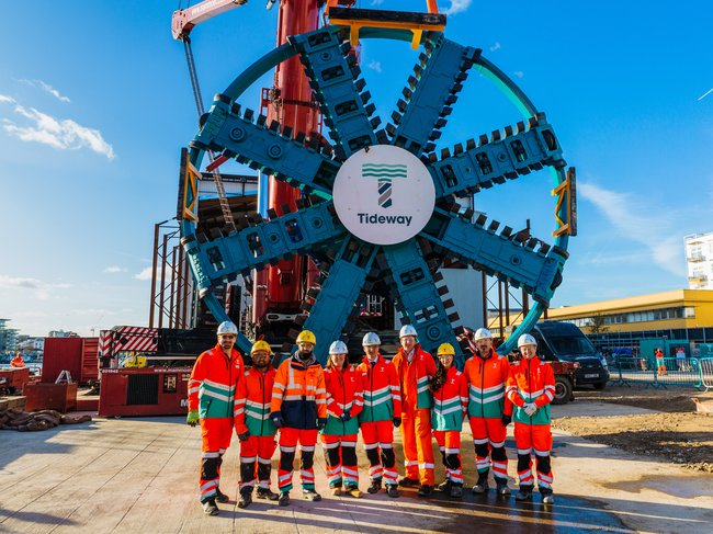 Members of the Thames Tideway Tunnel West Section team stood in front of one of the projects' Tunnel Boring Machines