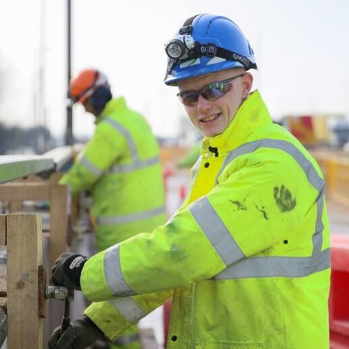 An apprentice wearing PPE is pictured working on site