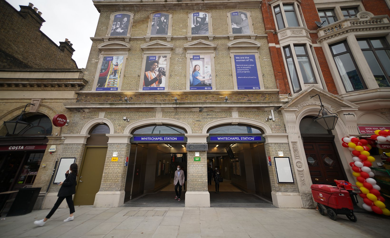 An exterior photograph of the entrance of the newly refurbished Whitechapel station, brick building with two open doorways and two floors above..