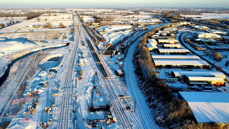 An aerial view of the Werrington Grade separation project, pictured covered in snow